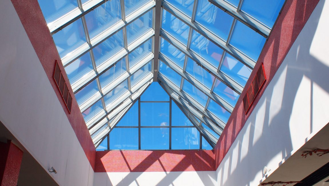 Upward view on the triangular glass roof
