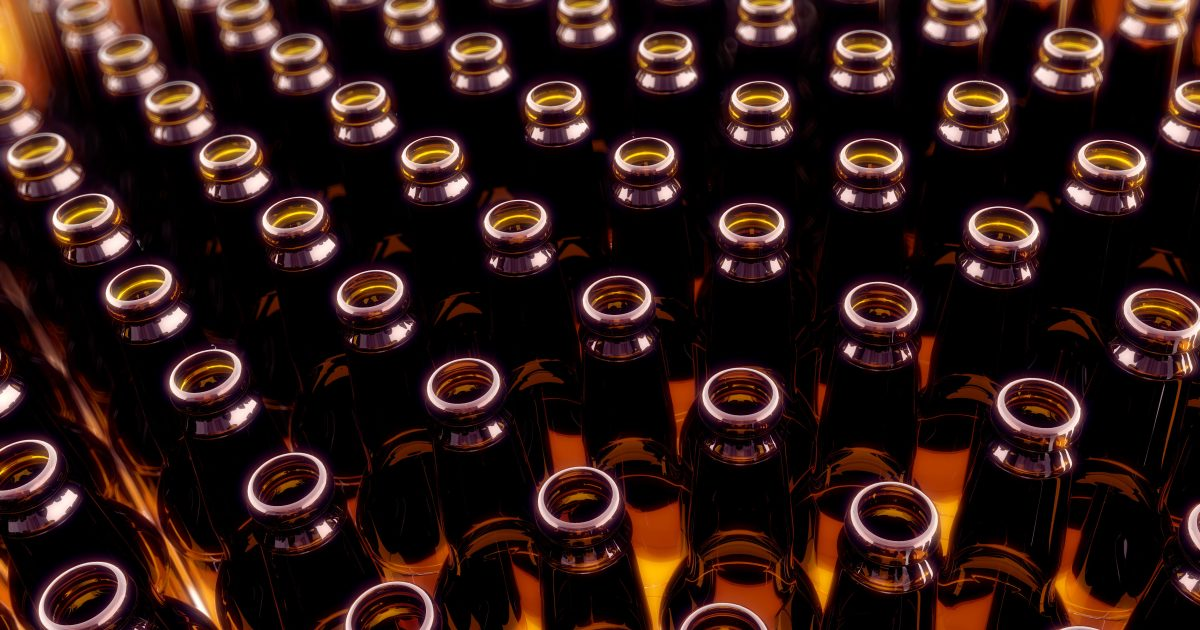 Empty brown beer bottle standing in a row