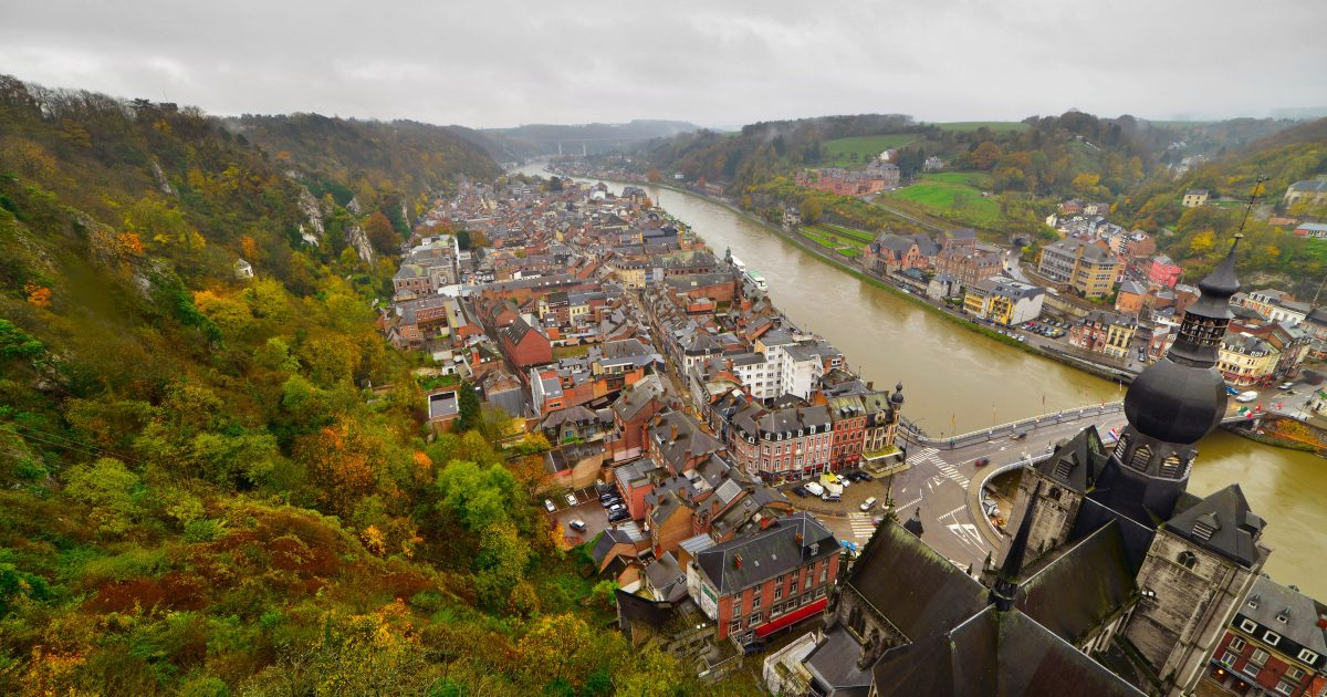 Top view of the city of Dinant with church on a cloudy day. Seen from the fortress. Belgium. Ardennes.
