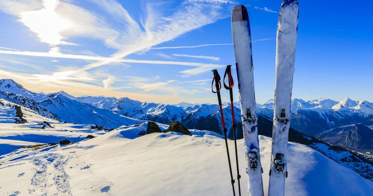 Ski in winter season, mountains and ski touring equipments on th