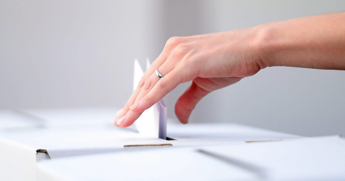 Woman casts her ballot at elections